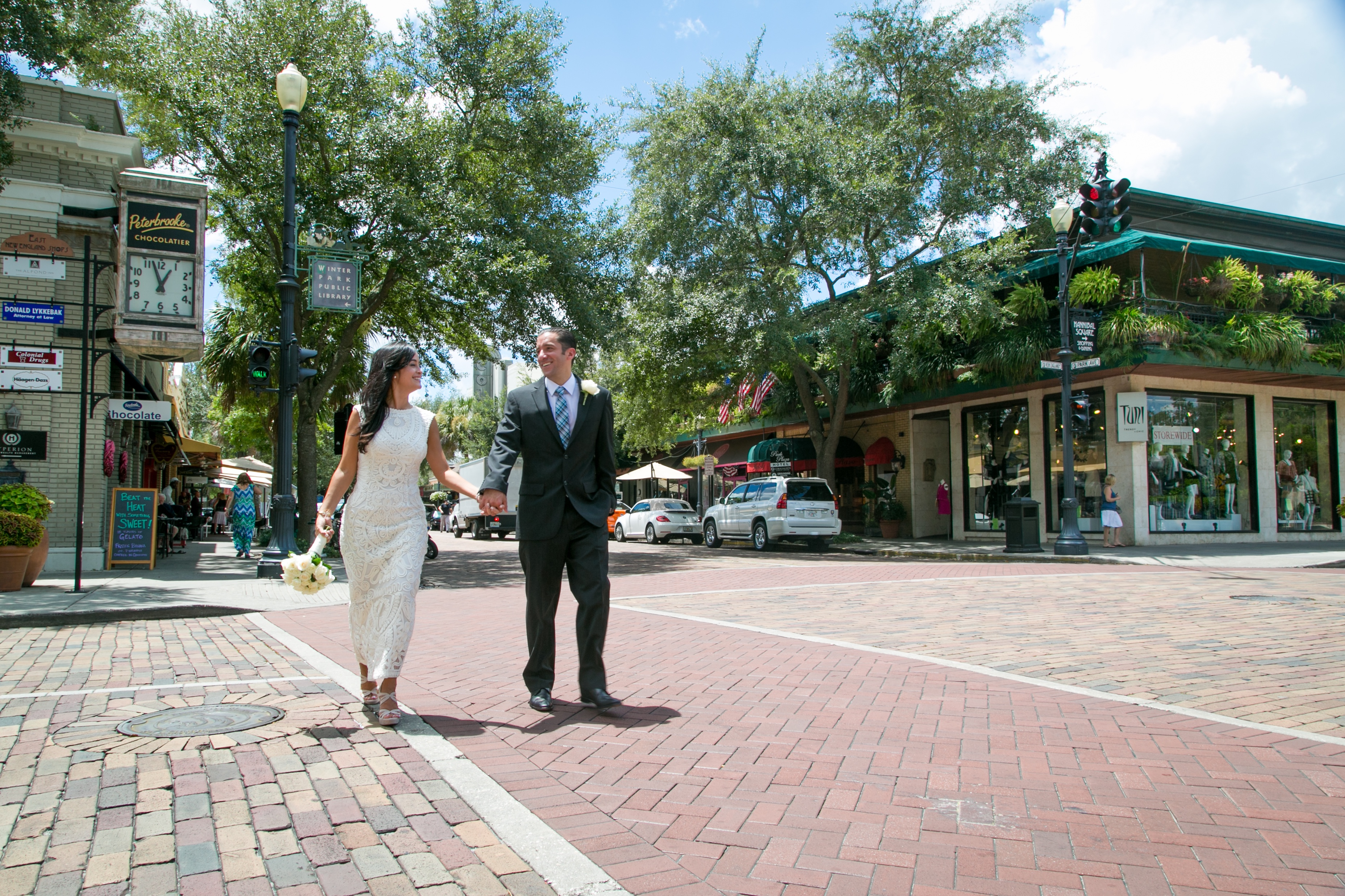 Crossing Park Ave, romantic shots downtown winter Park, photography by winter park photography, destination weddings