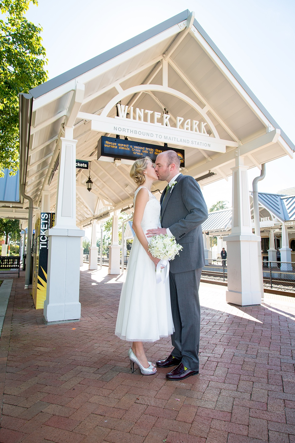 married in winter park, winter park florida, train station, newlyweds
