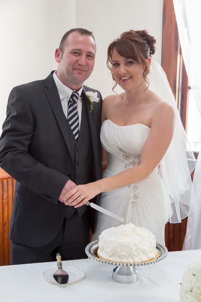 Cake cutting and a champagne toast for this UK couple