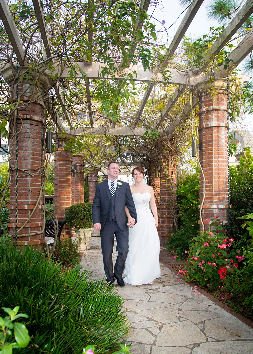 Kelly and Paul strolling through the gardens in Winter Park Florida