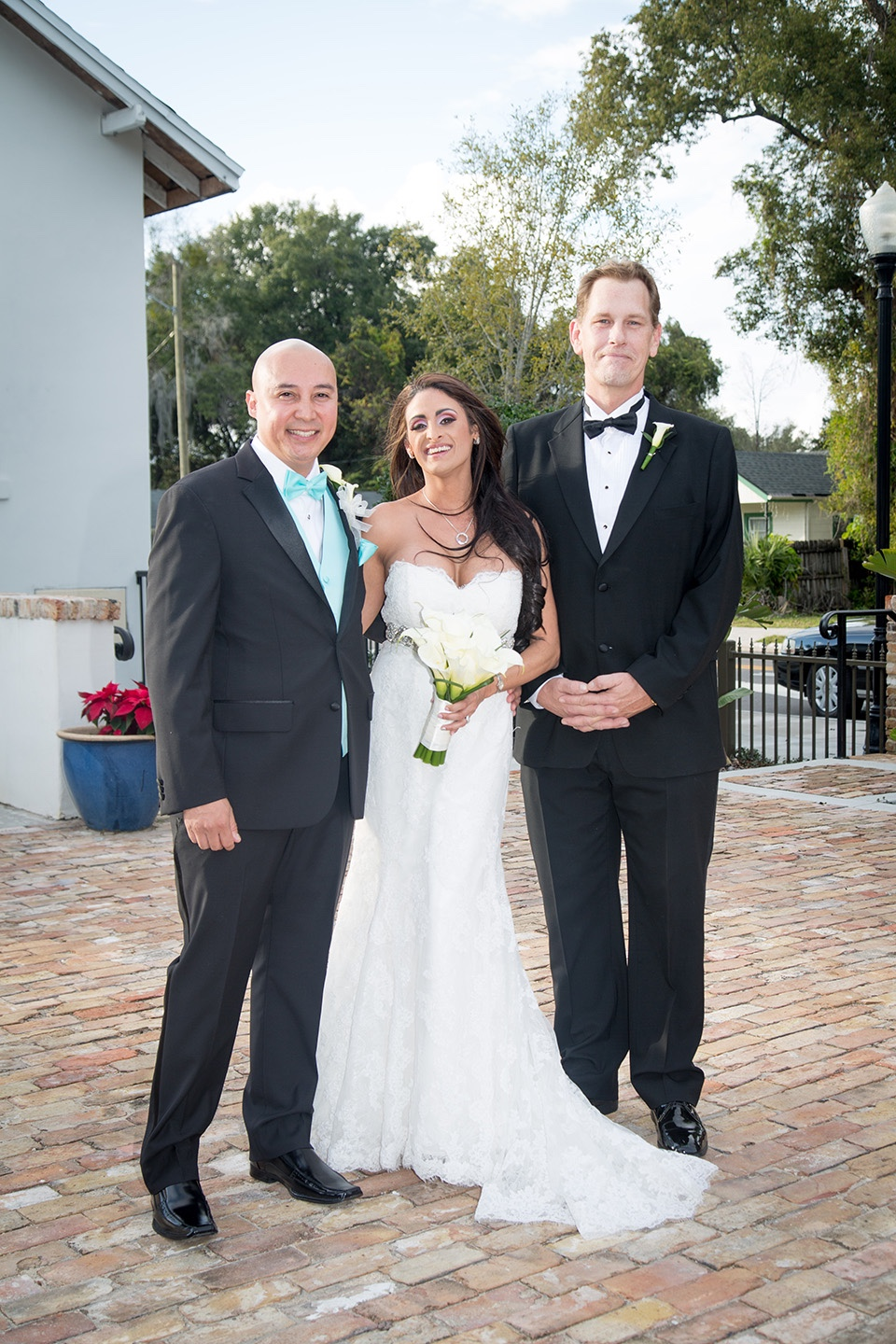 Photo with the best man in the courtyard of their historic Winter Park wedding venue