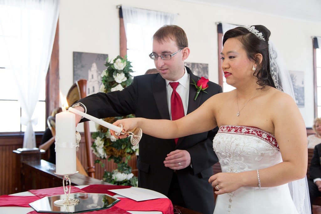 Allison and Ross performing a unity candle ceremony at the Winter Park Wedding chapel