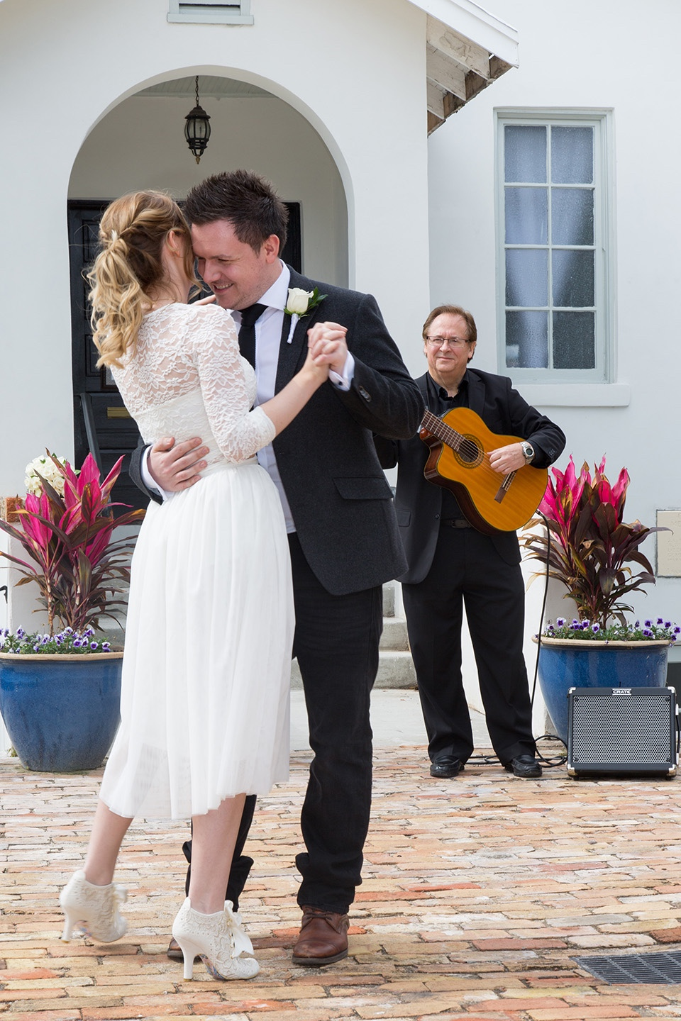 Kirstie and Mark's first dance outside their destination wedding venue in Central Florida