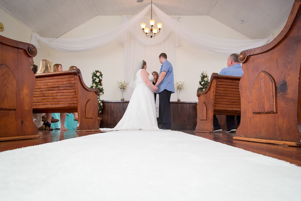 Claire & Nick saying their vows at the Winter Park Wedding Chapel