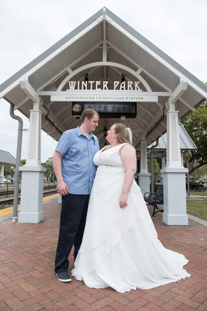 A photo under the Winter Park train station sign for this UK destination wedding.