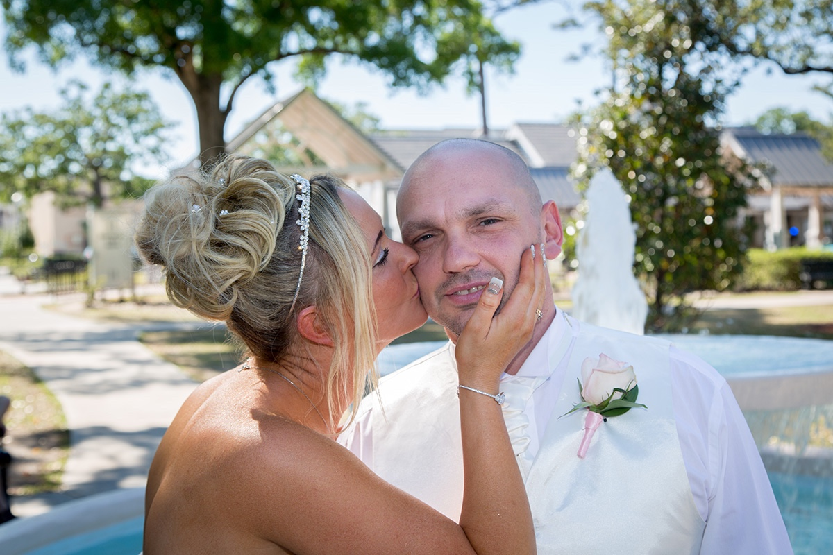 A kiss in Central Park, just one part of their Florida destination wedding.