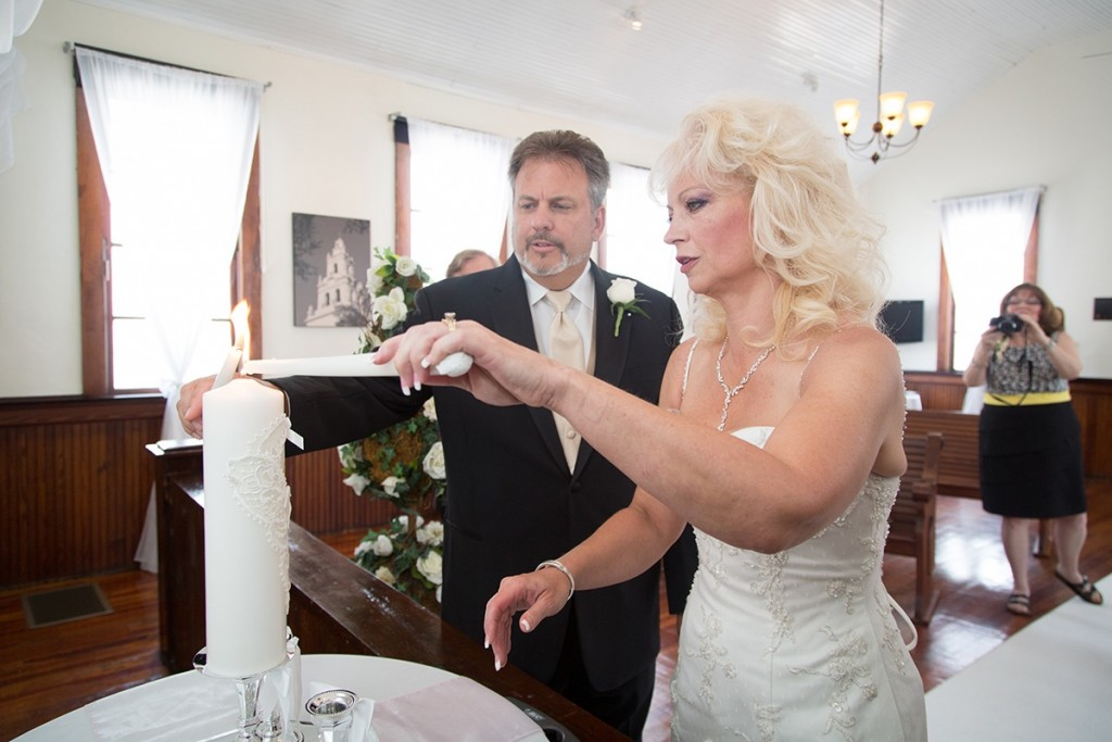 A unity candle ceremony at our historic Winter Park wedding venue.