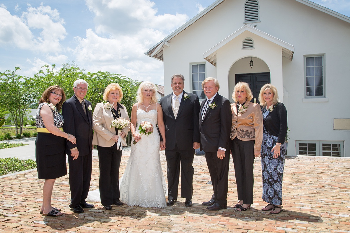Family and friends gathering for a photo in front of the Winter Park Wedding Chapel
