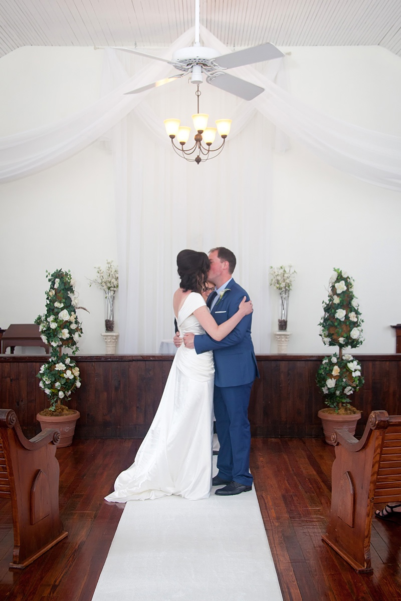 Clare & David's first kiss as husband and wife at the Winter Park Wedding Chapel