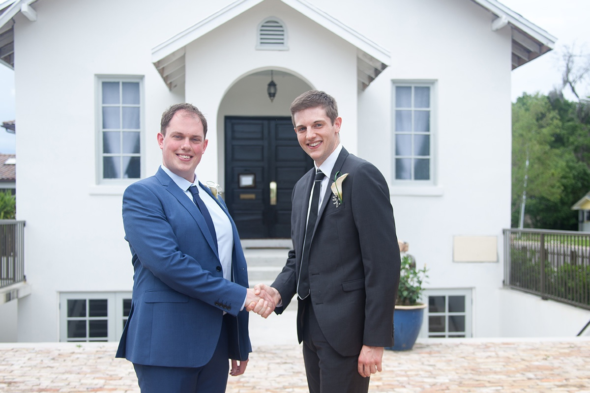 A handshake between groom and best man at this UK destination wedding