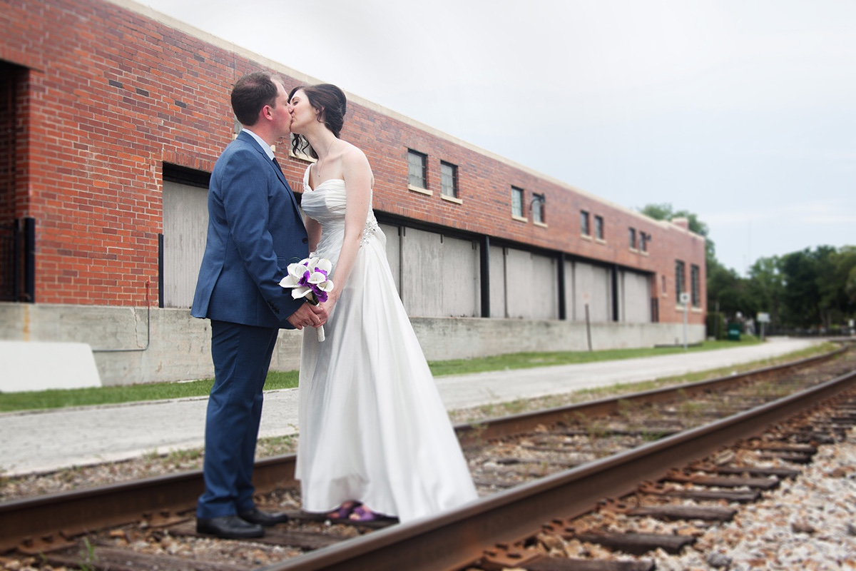 Some romantic photos of the newlyweds on the train tracks in Winter Park Florida